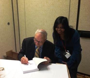 Dr. Bandura signing a book for a student at MPA, 2013.
